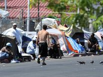 A group of homeless people take refuge beside a street in Las Vegas