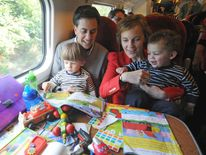 Labour Party Leader Ed Miliband travels with his wife Justine and children Daniel and Sam (right) on the train to Manchester ahead of the LabourÕs Annual Conference.