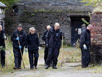Welsh Police Officers search near a house called Mount Pleasant in the village of Ceinws, believed to be the last residence of Mark Bridger, suspect in the abduction of April Jones.