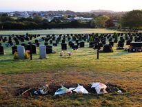 A general view showing flowers left on the grave of Sir Jimmy Savile