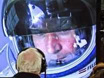 In this photo provided by Red Bull, pilot Felix Baumgartner of Austria is seen in a screen at mission control center in the capsule during the final manned flight for Red Bull Stratos in Roswell, N.M. on Sunday, Oct. 14, 2012.