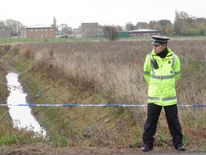 Police at the scene where the body of a teenage boy has been found in a ditch close to the Boulevard in Edenthorpe, Doncaster