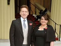 Kenneth Branagh knighted by the Queen accompanied by wife Lindsay