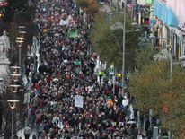 People march down O'Connell Street, Dublin, to demand legislation on abortion after the death of Indian woman Savita Halappanavar