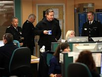 PM David Cameron visits an operations centre in Gloucestershire