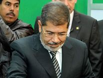 President Mohammed Morsi casts his vote in the Egyptian referendum