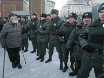 A man stands opposite police officers in Lubyanka Sqaure