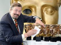 Bafta host Stephen Fry polishes the awards to be given at the ceremony