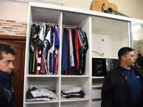 Racks of clothes and a guitar were also spotted in the cell
