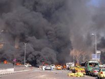 Cars burn after a boming in Damascus