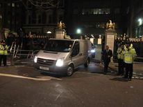 A private ambulance drives Baroness Thatcher's body from the Ritz Hotel in central London