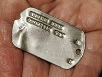 Irving Mann reunited with dog tags found in France field 69 years later