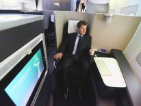 A mans sits in the first class cabin in a British Airways Airbus A380.