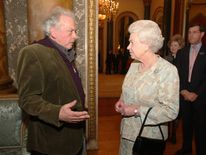The Queen meets photographer David Bailey during a reception at Buckingham Palace