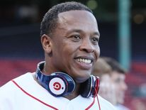 Dr Dre with his Beats by Dr Dre headphone