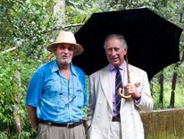 Prince Charles, the Prince of Wales, with his brother-in-law Mark Shand during a visit to the Vazhachal Forest Range, India.