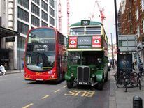 An old Routemaster bus is seen in Vauxhall Bridge Road, London, as extra buses were brought in on the first day of a 48 hour strike by tube workers.