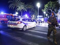 French soldiers and police secure the area after at least 30 people were killed in Nice, France, when a truck ran into a crowd celebrating the Bastille Day national holiday July 14, 2016. REUTERS/Eric Gaillard
