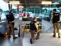Police secures the entrance to a subway station