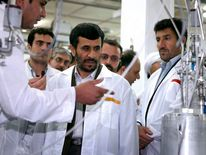 Mahmoud Ahmadinejad (C) visits the Natanz nuclear enrichment facility in south Tehran.