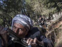 Free Syrian Army fighters near an army base near Aleppo