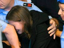 US student Amanda Knox reacts after hearing the verdict during her appeal trial session in Perugia