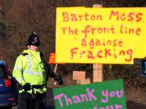 Anti-fracking campaigners protest against plans for exploratory drilling at Barton Moss