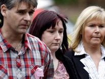 April Jones' parents Paul and Coral (left and centre) arrive at Mold Crown Court
