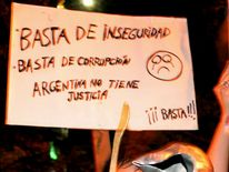 A boy bangs a pot during a protest outside the Presidential residence in Olivos