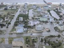 Handout aerial photo shows flooding from Hurricane Arthur on the Outer Banks of North Carolina