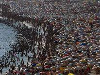 People enjoy Ipanema beach in Rio de Janeiro during a heatwave in Brazil