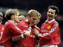 17 Oct 1998:  The Manchester United team celebrate David Beckham's  goal during the FA Carling Premiership match against Wimbledon at Old Trafford in Manchester, England