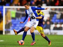 Oliver Lee of Birmingham is challenged by Alejandro Pozuelo of Swansea on