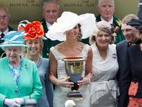 "The owners of Australian horse ""Black Caviar"" hold the trophy after receiving it from the Queen  on the final day at Royal Ascot"