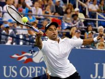 James Blake returns a forehand at the US Open in New York in 2013