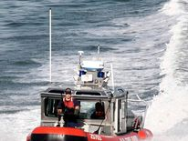 U.S. coast guard boat patrols Miami port after a suspicious device was detected near a cruise ship in the Port of Miami