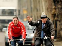 Mayor of London Boris Johnson and Chris Boardman (left) arrive on bicylcle for a press conference on Victoria Embankment to launch Crossrail for the Bike