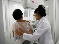 A woman undergoes a free mammogram.
