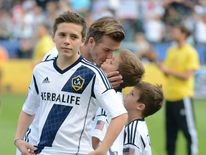 Brooklyn Beckham and his brothers are as big a fan of football as their dad David