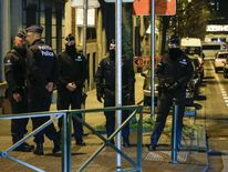 Police officers in Brussels conduct new searches linked to Paris attacks