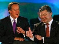 David Cameron laughs with Petro Poroshenko during the NATO summit