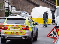 """Police Officers at the scene in Bracknell Close, Wood Green north London after a man died after being shot during an """"intelligence led"""" police operation."""