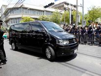 Van believed to be carrying former Thai PM Yingluck arrives at an army club after she was summoned by army during a coup in Bangkok