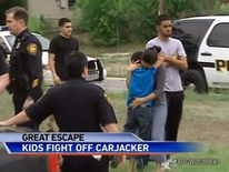 Twin boys beat off a carjacker in San Antonio by punching him and hitting him with a toy snake