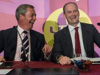 UKIP leader Nigel Farage (left) with  Douglas Carswell (right) during a press conference in central London where the Conservative MP defected to his party