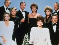 "Larry Hagman, center left, with fellow cast members of the television series ""Dallas."""
