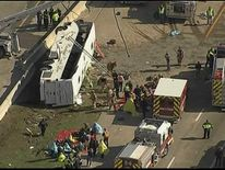 Passengers were trapped inside the bus after it rolled over, local media reported.