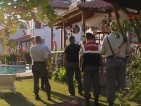 Police officers at the family's holiday home