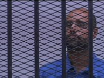 Saif Gaddafi appears in court on war criimes charges