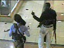 Two gunmen walk through Nairobi's Westgate shopping mall